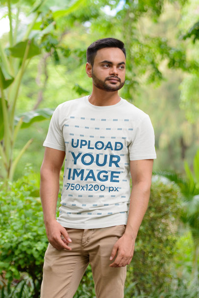 T-Shirt Mockup of a Bearded Man Standing by Tall Plants 44889-r-el2