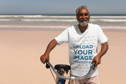 T-Shirt Mockup Featuring an Elderly Man with a Bike at the Beach 40487-r-el2