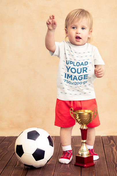 T-Shirt Mockup of a Little Boy with a Soccer Ball and a Trophy 43081-r-el2