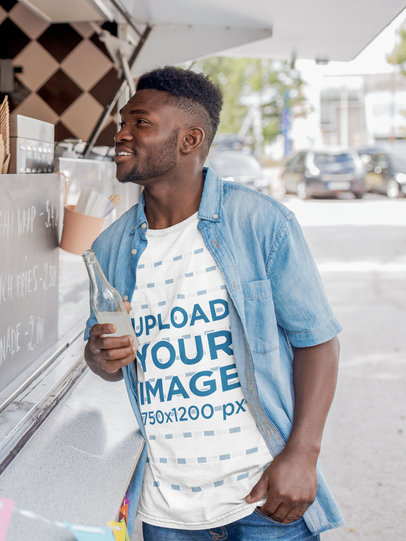 T-Shirt Mockup Featuring a Man Ordering at a Food Truck 44454-r-el2