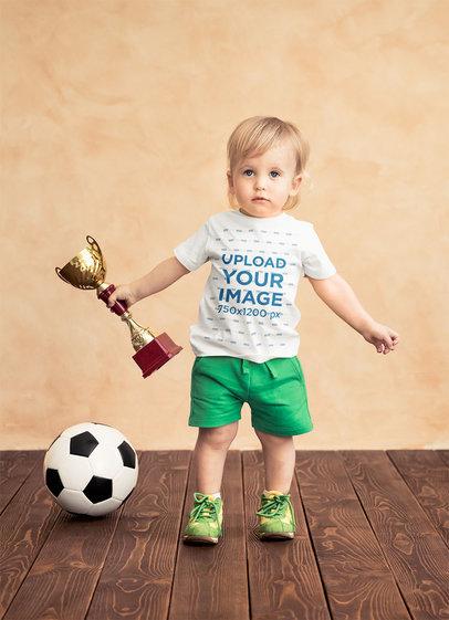 T-Shirt Mockup of a Baby Boy Holding a Soccer Trophy 43079-r-el2