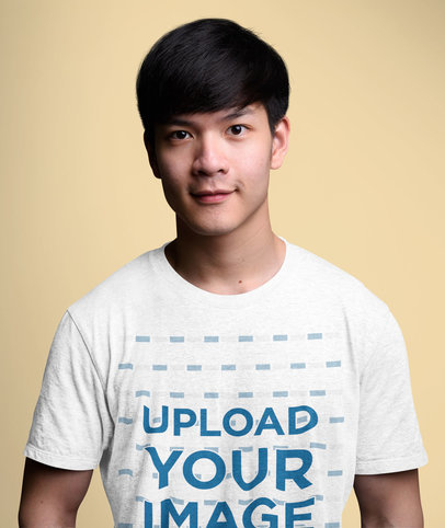 Heather T-Shirt Mockup of a Young Man Standing Against a Colored Backdrop 40317-r-el2