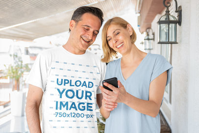 T-Shirt Mockup of a Man with a Woman Watching a Mobile Phone 44452-r-el2