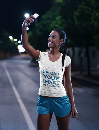T-Shirt Mockup of a Woman Taking a Selfie After a Nocturnal Run 41440-r-el2