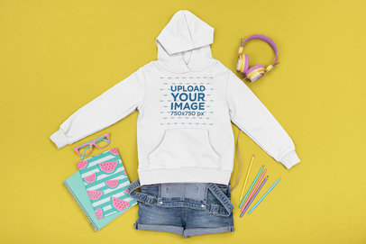Girl's Outfit Mockup Featuring a Hoodie Placed by Colorful School Supplies m1258