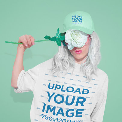 Mockup of a Woman Wearing a Tee and a Cap While Covering Her Face with a Flower 43088-r-el2
