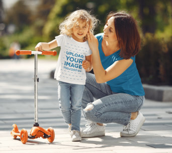 T-Shirt Mockup of a Happy Girl With a Scooter Standing by Her Mom 41557-r-el2