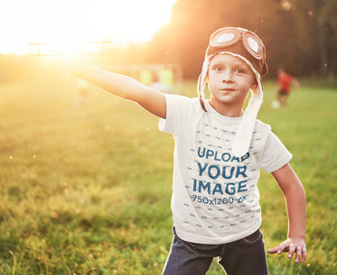 T-Shirt Mockup Featuring a Kid Playing With a Small Airplane Toy 46208-r-el2