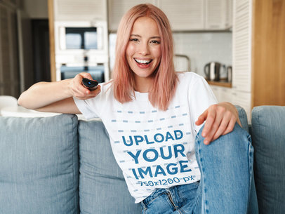 Mockup of a Woman With a Unisex T-Shirt Holding a TV Remote 41274-r-el2