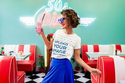 T-Shirt Mockup Featuring a Woman with a Milkshake at a Retro Restaurant m2133-r-el2