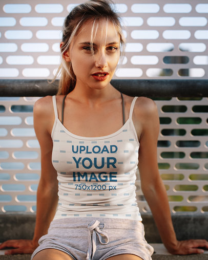 Mockup Featuring a Young Woman Posing in a Sublimated Tank Top M1847-r-el2