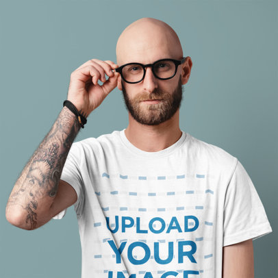 T-Shirt Mockup of a Man With Glasses and an Arm Tattoo at a Studio m1517-r-el2