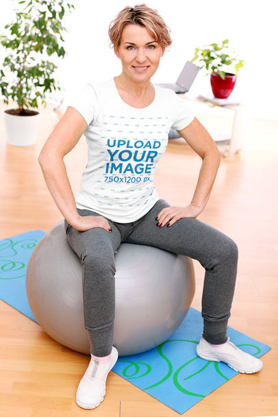 T-Shirt Mockup of a Woman Sitting on an Exercise Ball M1701-r-el2