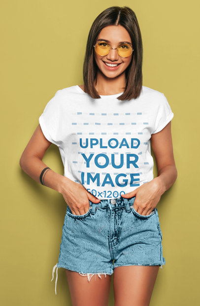 T-Shirt Mockup of a Young Woman Posing in a Studio with Her Hand in Her Pockets m1356-r-el2
