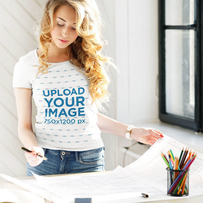 T-Shirt Mockup Featuring a Young Architect at Work M1699-r-el2