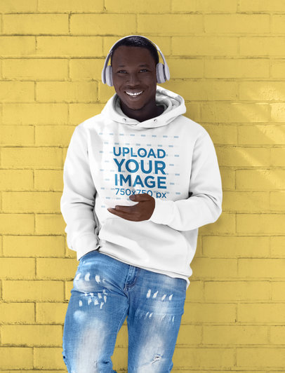 Hoodie Mockup of a Man Listening to Music While Leaning on a Colored Wall M2146-r-el2