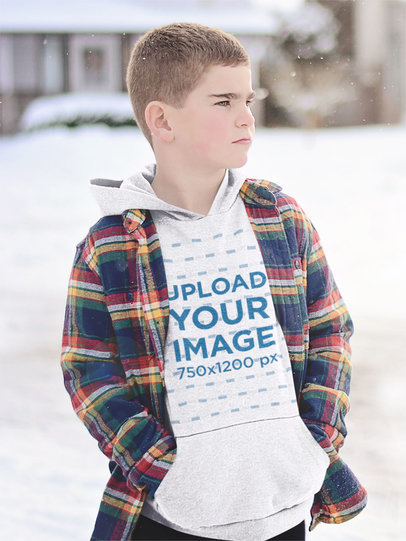 Heather Hoodie Mockup of a Serious Kid Posing on a Snowy Day m2225-r-el2