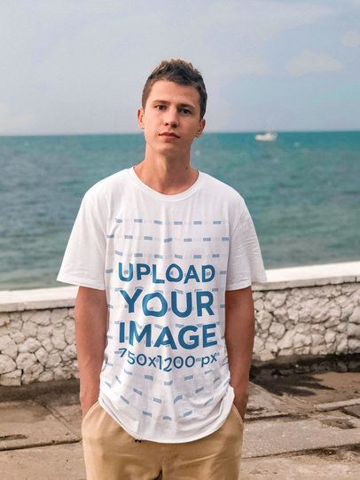 Mockup of a Young Man Wearing a Loose T-Shirt by the Ocean m1572-r-el2