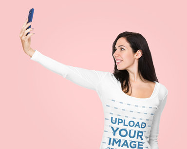 Long Sleeve Tee Mockup of a Woman Holding Her Phone Up for a Selfie m2135-r-el2