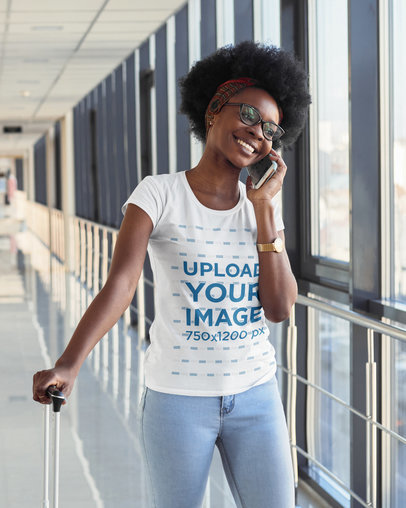 T-Shirt Mockup of a Woman Talking on the Phone While at the Airport m2302-r-el2