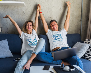T-Shirt Mockup Featuring a Happy Couple Sitting on a Couch m2554-r-el2