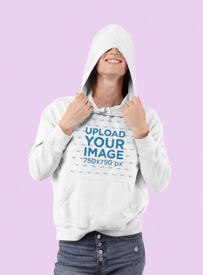Mockup of a Happy Woman Wearing a Hoodie in a Studio 32942a