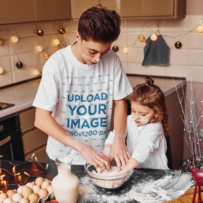 Basic T-Shirt Mockup of Teenage Boy Baking With His Little Sister m2202-r-el2