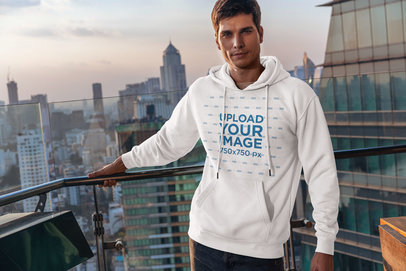 Hoodie Mockup of a Man Posing by the View of a Big City 5128-el1