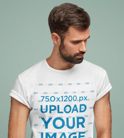 T-Shirt Mockup of a Serious Bearded Man Standing in a Studio M2616-r-el2