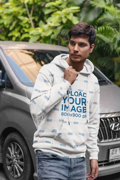 Mockup of a Man Wearing a Hoodie While Posing Next to a Truck 5126-el1