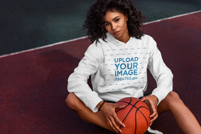 Hoodie Mockup Featuring a Curly-Haired Woman Sitting on a Basketball Court 5134-el1
