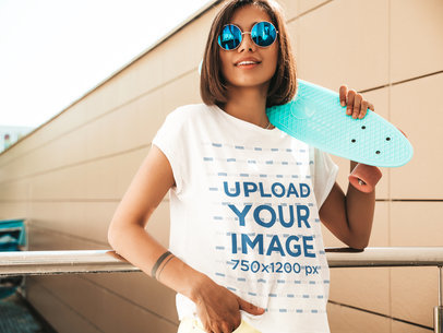 Round-Neck Tee Mockup of a Young Woman Carrying a Penny Board M1724-r-el2