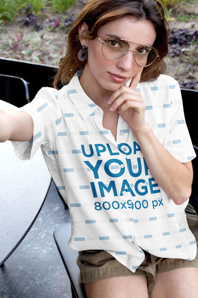 Mockup of a Woman Wearing a Sublimated Button-up Shirt Taking a Selfie 33130a
