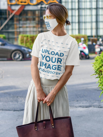 T-Shirt and Face Mask Mockup Featuring a Stylish Woman on the Street m2155-r-el2