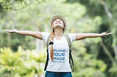 Tee Mockup of a Joyful Woman with Arms Wide Open Enjoying Nature m2825-r-el2