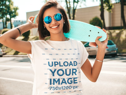 T-Shirt Mockup Featuring a Happy Woman With Sunglasses Holding a Small Skateboard m1506-r-el2