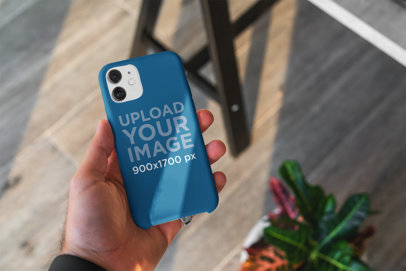 Mockup of a Man's Hand Holding a Phone With a Customizable Case 5168-el1