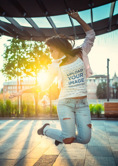 Tank Top Mockup Featuring a Woman Jumping with a Sunset Background m3232-r-el2
