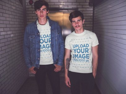 Two Young White Guys Wearing Different Round Neck Tees Mockup While Standing in a Corridor a15696