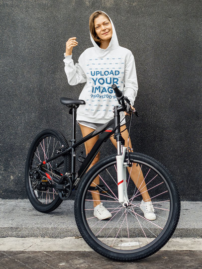 Hoodie Mockup of a Woman Posing with a Mountain Bike m3288-r-el2