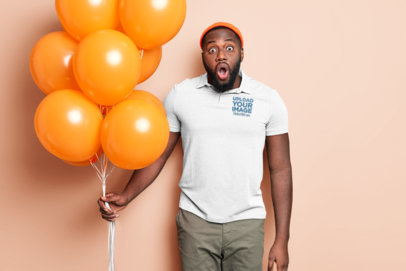 Polo Shirt Mockup of a Surprised Man Holding Some Balloons M3312-r-el2