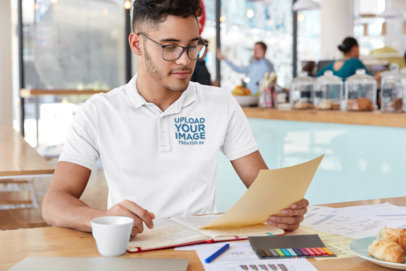 Polo Shirt Mockup Featuring a Young Man Working at a Cafe M3309-r-el2