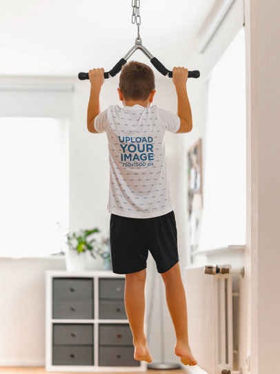 Back-View Tee Mockup of a Little Kid Doing Pull-Ups at Home m2432-r-el2