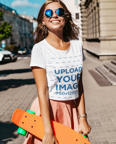 T-Shirt Mockup of a Happy Young Woman Holding a Penny Board M1534-r-el2