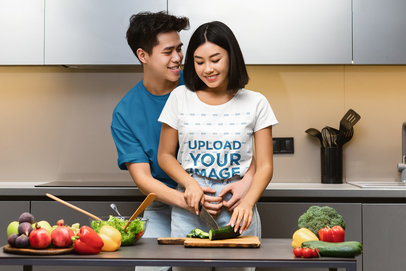 T-Shirt Mockup of a Woman Cooking While Her Boyfriend is Hugging Her m3426-r-el2