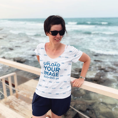 Sublimated T-Shirt Mockup of a Woman with Sunglasses at the Beach 45594-r-el2