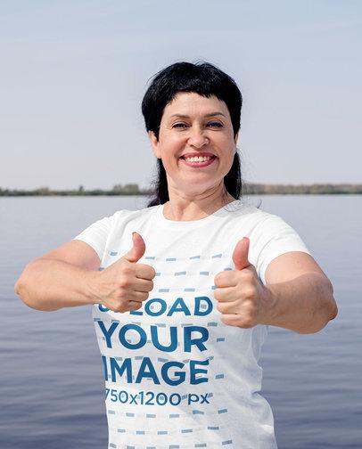 Basic T-Shirt Mockup of a Joyful Woman Posing by a Lake 46238-r-el2