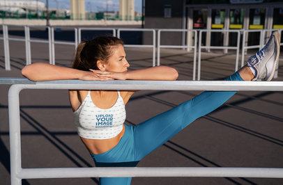 Sports Bra Mockup of a Chill Woman Stretching Her Leg m3695-r-el2