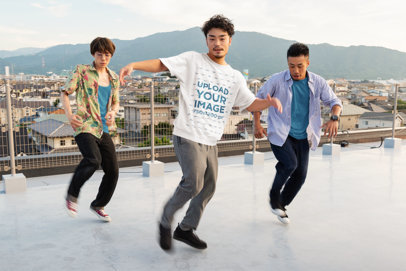 Oversized T-Shirt Mockup Featuring a Man Breakdancing at a Rooftop 39450-r-el2