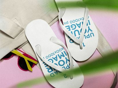 Two Flip Flops Mockup Lying on a Pink Surface Near a White Towel a15437
